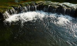 Water Flow in a pond. Artificial Water Flow in a pond in Hong Kong Park royalty free stock photos