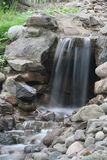 Artificial waterfall. In the garden Royalty Free Stock Photography