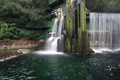 Artificial waterfall. A chinese restaurant with artificial waterfall outside Royalty Free Stock Images