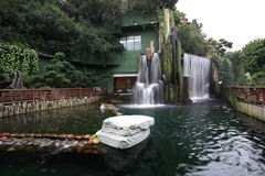 Artificial waterfall. A chinese restaurant with artificial waterfall outside Stock Images