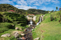 Artificial waterfall with blue sky in Cameron Highlands. Malaysia Stock Photos
