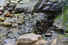 Artificial waterfall on decorative stones Royalty Free Stock Photography