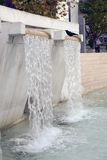 Artificial waterfall - Fountain (5868). Crow drinking at waterfall fountain at a promenade Stock Images