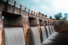 artificial waterfall in the river under bridge royalty free stock photo
