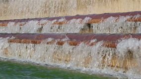 An artificial waterfall. View of an artificial waterfall with rows of waves stock video footage