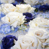 Artificial white and blue roses Stock Images