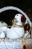 Artificial White dove in a basket with gold bracelets and chains with gems Royalty Free Stock Photos