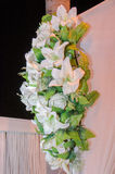 Artificial white lilies on a white wall - design for the wedding Stock Image