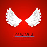 Artificial white paper wings on red background. Stock Photos