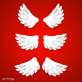 Artificial white paper wings set. Stock Photo