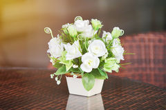 Artificial white rose in ceramic vase Stock Photography