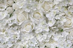 Artificial white rose and flowers background stock photography