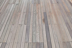Artificial wood floor weathered background Stock Photos