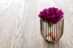 Artificial wood flowerpot on wooden table, small light brown colour in room royalty free stock photo