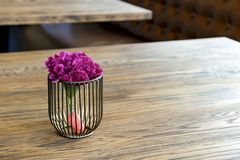 Artificial wood flowerpot on wooden table, small light brown colArtificial wood flowerpot on wooden table, small light brown colou stock photos