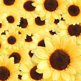 Artificial yellow sunflowers background. Full artificial yellow sunflowers background Stock Photos
