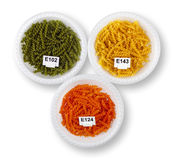 Artificially colored pasta in plates Royalty Free Stock Image