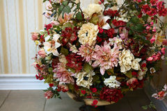 Artifitial flowers composition in house interior Royalty Free Stock Image
