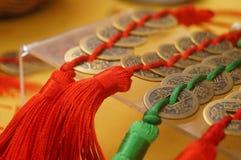 Artigianato fatti delle monete cinesi antiche fotografie stock