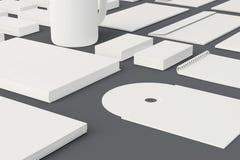 Artigos de papelaria vazios e molde incorporado da identificação isolados no cinza Imagens de Stock