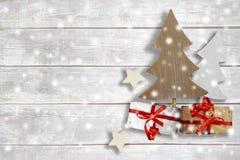 Artigos do Natal no fundo de madeira Fotos de Stock Royalty Free
