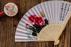 Artigos tradicionais chineses - dobramento e chocalho Fotografia de Stock
