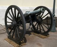 Artillery cannon. Antique bronze artillery cannon on wheels, napoleontic era Royalty Free Stock Images