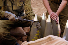 Artillery Corps - Israel. NACHAL OZ , ISR - DEC 30:Israeli artillery soldiers prepare shells to be fired on Dec 30 2005.The IDF artillery corp using advanced Stock Photo