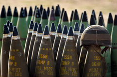 Artillery Corps - Israel. NACHAL OZ , ISR - MAY 30:Israeli artillery soldier helmet on live shells ready to be fired  on May 30 2005.The IDF artillery corp using Royalty Free Stock Photography