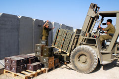 Artillery Corps - Israel. NACHAL OZ , ISR - MAY 30:Israeli artillery soldier preparing a new stock of armory on May 30 2005.The IDF artillery corp using advanced Stock Photos