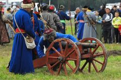Artillery detachment by the cannon Stock Images