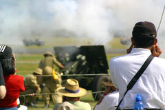 Artillery exhibition. World War One artillery guns being fired in an demonstration and re-enactment Royalty Free Stock Images