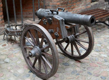 Artillery piece of the XVIII century on a wooden gun carriage Royalty Free Stock Photography