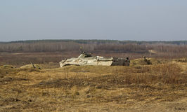 Artillery tank on military hiding in grass Royalty Free Stock Photography