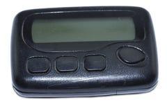Artilugio del vintage para el dispositivo de comunicación Paginador viejo negro aislado en el fondo blanco imagen de archivo