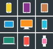 Artilugios electrónicos coloreados modernos planos Fotografía de archivo libre de regalías