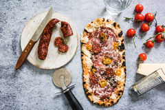 Artisan baked pizza with ingredients Royalty Free Stock Photo