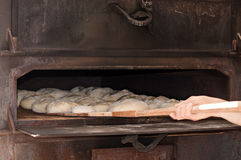 Artisan baker. Working in traditional fair Stock Photos