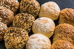 Artisan bakery buns and rolls. On dark slate background from above stock image