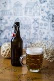 Artisan beer. Bottle and pint of artisan beer Stock Photos