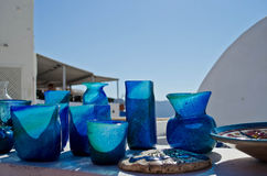 Artisan blue glass vases in Greece. Decorative handmade artisan blue glassware in Santorini, Greece Royalty Free Stock Photos