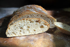 Artisan Bread. A loaf of sliced artisan bread showing the open crumb royalty free stock image