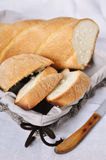 Artisan bread. In basket with serrated knife Royalty Free Stock Photography