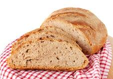 Artisan bread. Cut artisan bread on a napkin Royalty Free Stock Photo