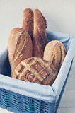 Artisan bread in basket. Artisan boule, batard and baguettes in blue basket Stock Photography