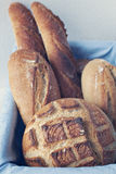 Artisan bread in basket Stock Images