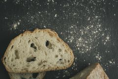 Artisan bread on black slate rock plate stock photos