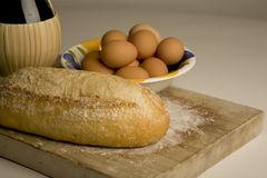 Artisan bread on cutting board. Royalty Free Stock Images