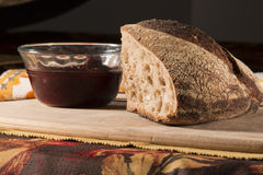 Artisan Bread. Bread and Olive Oil with table setting on bamboo cutting board. Fall napkin in background stock image
