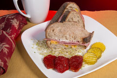 Artisan Bread Sandwich. With sun dried tomatos and butter pickle slices on a white plate stock images
